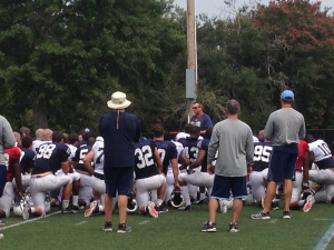 Coach Houston rallies the troops after their 1st day in pads