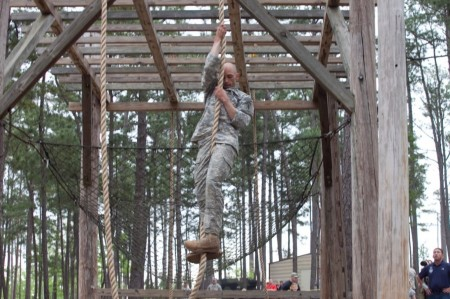 Capt. Robert Killian climbs a robe during the Best Ranger competition on April 12 at Fort Benning, Ga. (Markeith Horace for the U.S. Army)