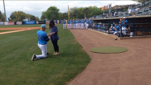 Citadel pitcher Zach Sherrill proposes to girlfriend Anna Kate Shuler before Saturday's game at Riley Park. (Photo provided)
