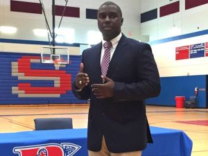 Justin Woodberry ('06 T Co.) addresses a gathering in the Riverside High gymnasium Monday after being introduced as the school's new boys basketball coach.(Photo: BOB CASTELLO / Staff)