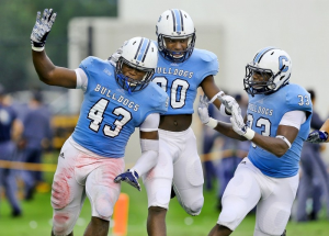 Citadel's Tevin Floyd, Mariel Cooper, and Quinlan Washington celebrate Floyd's touchdown against Davidson during their game Saturday, Sept. 5, 2015 at Johnson Hagood Stadium. Paul Zoeller/P&CStaff