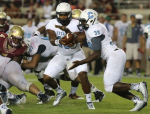 Dominique Allen (middle), shown here against Florida State last season, was named The Citadel's starting quarterback this week. file/ap