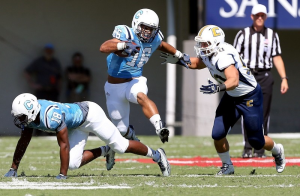 Vinny Miller (with ball) and Cam Jackson (on ground) will start at slotback for The Citadel in Saturday's season opener against Davidson (Paul Zoeller/Staff)